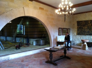 In the tasting room - you can see the wooden vat room through the windows.  Regretfully, we did not get a photo of their beautiful vat room.