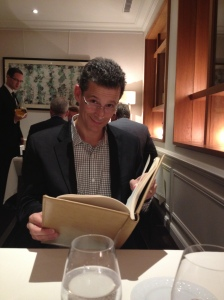 Bob reading his favorite book - the restaurant wine list!