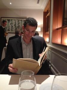 Bob reading his favorite book - the restaurant wine list!