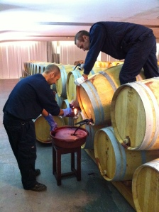 The laborious process of fining the wines.