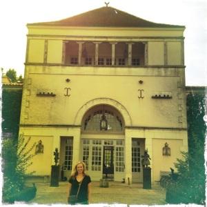 Christina at the front entrance of Les Sources de Caudalie.
