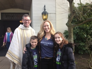 Father Glen Butterworth with Bobby, Christina and Sophia Watt.  Praying for a Hawks win!